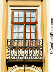 Facade of a building with a balcony. The building is...