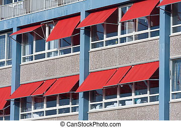 Facade of a building with red sunshades