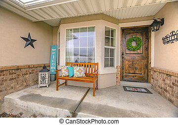 Facade of a home with a wooden bench on the welcoming front porch