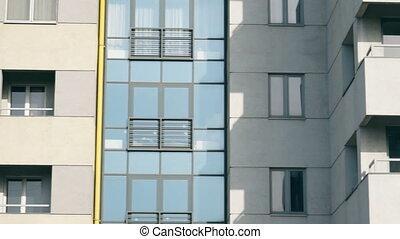 abstract apartment building establishing shot - Facade of a...