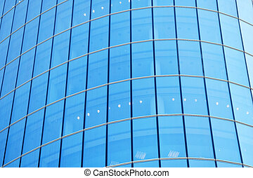 Facade of a modern skyscraper from large glass windows.