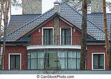 facade of a private red brick house with a covered veranda