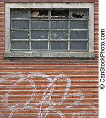 facade of abandoned building with broken windows and graffiti