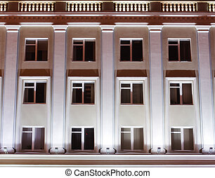 facade of an office building at night