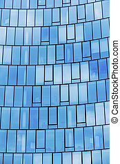 facade of an office building - the window front of a modern...