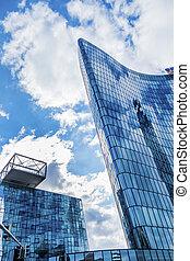 facade of an office building - the windows of a modern...
