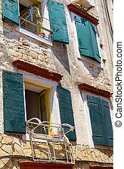 Facade of an old house in a narrow street in Gaios port town on