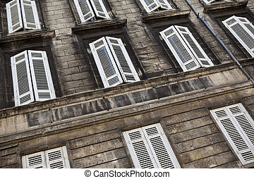 Facade of an old stone building in Bordeaux, France