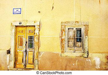 Facade of antique ruined house, Algarve, Portugal