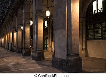 Facade of building with columns and lanterns