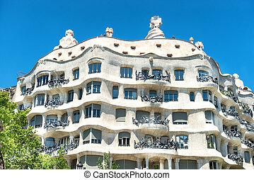 Facade of Casa Mila in Barcelona - Facade of Casa Mila with ...