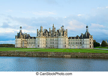facade of Chambord chateau at sunset, France