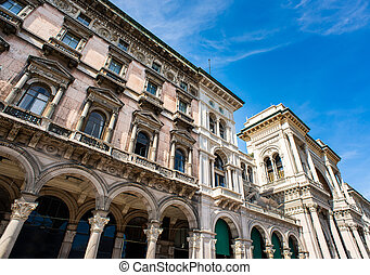 Facade of Galleria Vittorio Emanuele II and Old Beautiful Building on Duomo Square (Piazza del Duomo) in Milan.
