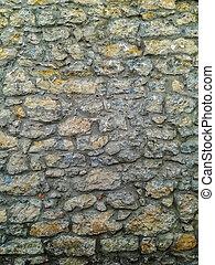 Facade of gray natural stone