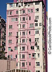 facade of houses downtown Kowloon with appartments and air...