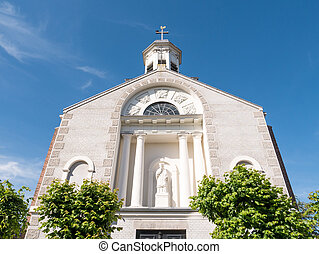 Statue of Saint John of Nepomuk in front facade of Parish Church in old town of fortified city Woudrichem, Brabant, Netherlands
