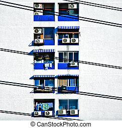 facade of skyscraper with appartments in Bangkok