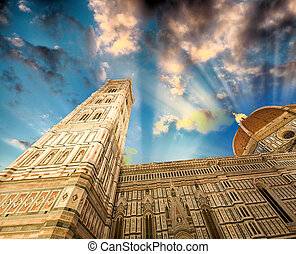 Facade of the Basilica of Saint Mary of the Flower in Florence at sunset time light, UNESCO World Heritage Site, Italy, Europe.