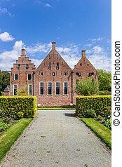 Facade of the historic Menkemaborg building in Uithuizen