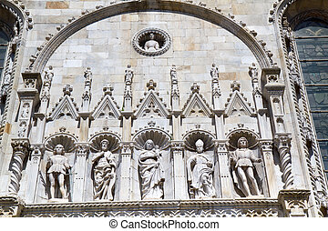 Facade of the medieval Como cathedral on Lake Como in Italy, Lombardy