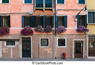 Facade of the old house in Venice