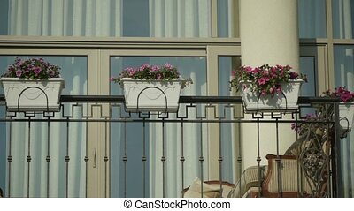 Facade of the restaurant. Balcony of beautiful home. Flowers...