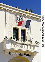 facade of the town hall of the French town of Saintes-Maries-de-la-Mer in the Camargue region.