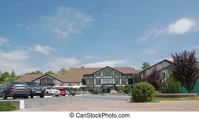 Facade of vacation center country nature hotel with parking slow motion camera movement