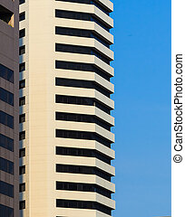 Facade of White Office Building in Morning Sunlight, Blue Sky
