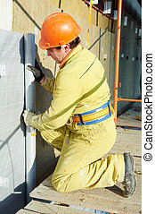 Facade Plasterer at exterior insulation work - Facade...