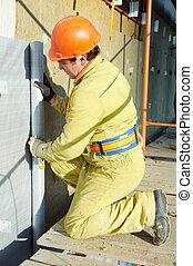Facade Plasterer at exterior insulation work - Facade ...