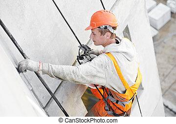 Facade Plasterer worker at work - Facade plasterer at ...