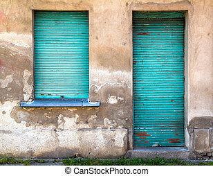 facade of old building with turquoise shutters