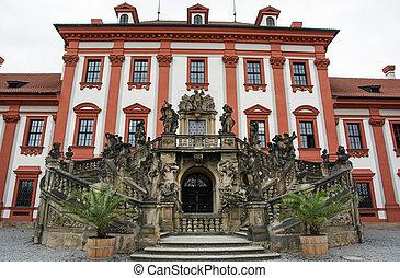 Facade with beautiful sculpture of Troja castle in Prague