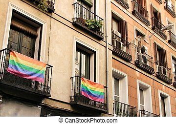 Facade with gay pride flag in Madrid