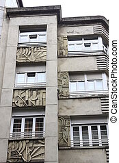 Facades of buildings with carved stone