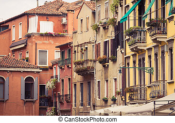 Facades of houses on a street in Venice, Italy