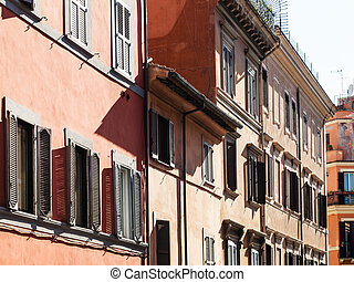 facades of old house on street in Rome city