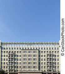 Facades of old socialist GDR era apartment buildings on Karl...