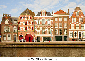 facades of old town of Harlem over Spaarne river, ...