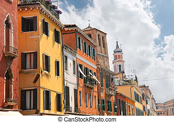 Facades of the houses on the street in Venice, Italy