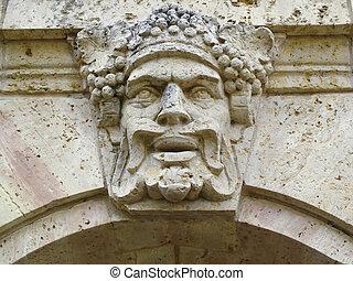 faccia, intagliato, in, vecchio, muro pietra