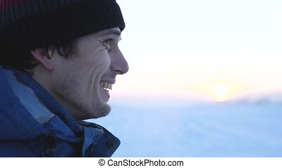 Face at profile of unshaved happy handsome man in winter