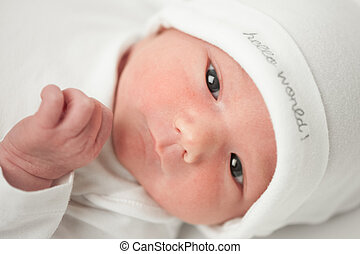face baby in a white hat