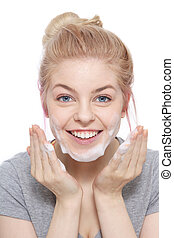 Face cleaning - Portrait of young beautiful happy smiling...
