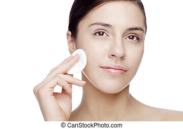 face cleansing - female with cotton, removing makeup or ...