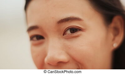 Face close-up. Charming Vietnamese Girl laughing. - Charming...