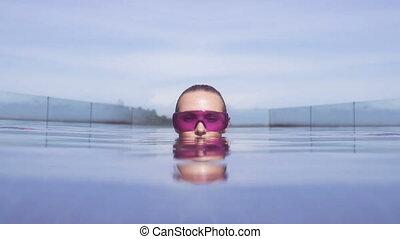Face closeup of woman in pool