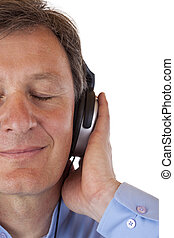 Face cut of happy senior man with headphones listening to mp3
