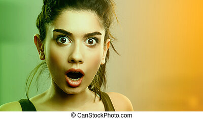 Face expression of shocked surprised young woman